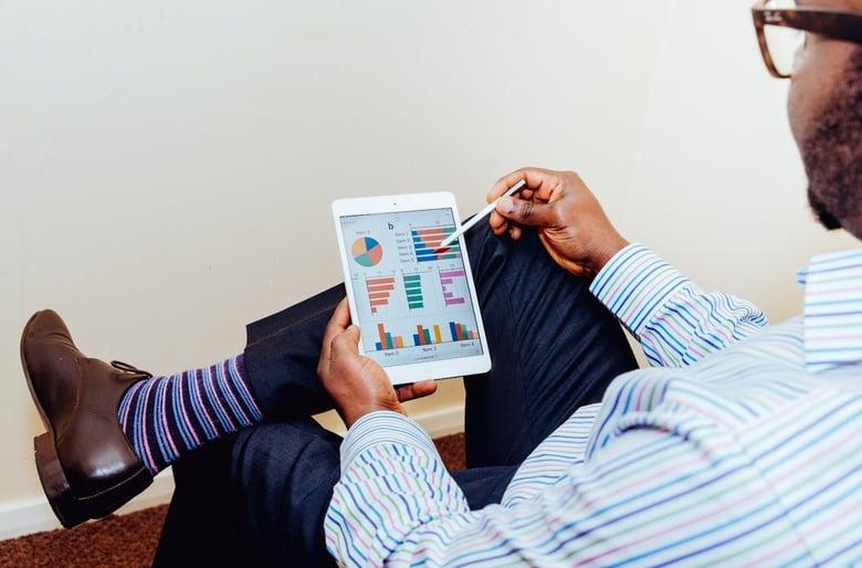 Man examining balance sheet data with ZarMoney App